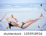 a woman is relaxing  on the... | Shutterstock . vector #1353918926