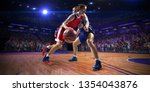 basketball player n action.... | Shutterstock . vector #1354043876