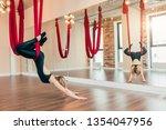 yogi female trainee learning to ... | Shutterstock . vector #1354047956