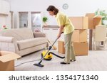 middle aged woman cleaning new... | Shutterstock . vector #1354171340
