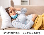 sick pregnant woman suffering... | Shutterstock . vector #1354175396
