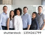 smiling diverse office workers... | Shutterstock . vector #1354261799