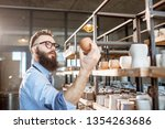 creative worker checking... | Shutterstock . vector #1354263686