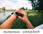 the girl looks at the clock... | Shutterstock . vector #1354265429
