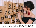 the girl selects a date.... | Shutterstock . vector #1354265453