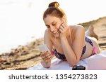 the smiling sunbathing woman is ...   Shutterstock . vector #1354273823