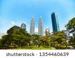 petronas towers in kuala lumpur.... | Shutterstock . vector #1354460639