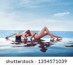 sensual  young woman realxing... | Shutterstock . vector #1354571039
