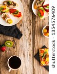 breakfast table with tasty... | Shutterstock . vector #1354576409