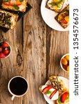 breakfast table with tasty... | Shutterstock . vector #1354576673