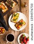 breakfast table with tasty... | Shutterstock . vector #1354576733