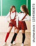 two pretty schoolgirls in... | Shutterstock . vector #1354580873