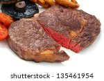 rib eye steak on white plate | Shutterstock . vector #135461954