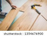 Flooring services - laminate installation in a floating way - stock photo