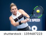 Small photo of Miami Gardens, Florida / USA - March 28 2019: Simona Halep of Romania returns a ball during play at the Miami Open presented by Itau at Hard Rock Stadium March 28, 2019 in Miami, Gardens Florid