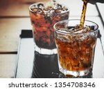 pouring cola drink on glass | Shutterstock . vector #1354708346