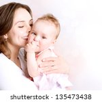 mother and baby kissing and... | Shutterstock . vector #135473438