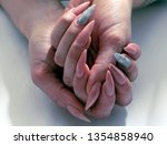 beautiful female hands with...   Shutterstock . vector #1354858940