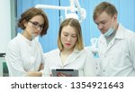 team of doctors discuss... | Shutterstock . vector #1354921643