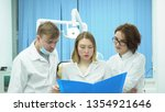 team of doctors discuss... | Shutterstock . vector #1354921646
