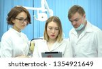 team of doctors discuss... | Shutterstock . vector #1354921649