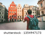 Small photo of Man tourist sightseeing Stockholm city Gamla Stan landmarks traveling lifestyle girl taking photo by smartphone Europe trip summer vacations