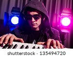 dj mixing music at disco | Shutterstock . vector #135494720