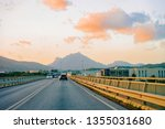 cars on summer road at sunset... | Shutterstock . vector #1355031680