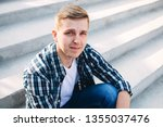 the guy in the plaid shirt sits ... | Shutterstock . vector #1355037476