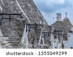 the traditional trulli houses... | Shutterstock . vector #1355049299