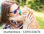 Stock photo people summer tourism and nature concept young woman with cat near tent 1355110676