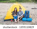 Stock photo people tourism and nature concept couple having fun on camping trip with cat 1355110829