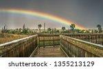 Rainbow And Dark Rainy Sky At...