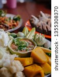 Stock photo nam prik pla to thai chili paste dip with mackerel fish meat and fresh vegetables pumpkin 1355308370