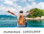 man traveler relaxing on boat... | Shutterstock . vector #1355313959