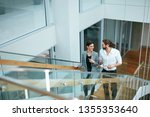business people in office going ... | Shutterstock . vector #1355353640