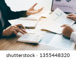 two young colleagues using... | Shutterstock . vector #1355448320