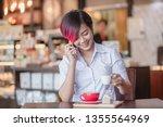 short hair and purple hair she... | Shutterstock . vector #1355564969