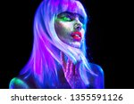 Stock photo fashion model woman in neon light beautiful model girl colorful bright fluorescent make up 1355591126