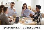 happy mixed race office workers ... | Shutterstock . vector #1355592956
