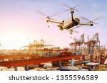 white drone with camera flying... | Shutterstock . vector #1355596589
