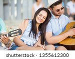 young beautiful couple with a... | Shutterstock . vector #1355612300