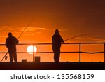 Fishing Off The Pier  Sunset