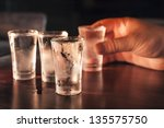 shot glasses of vodka on a... | Shutterstock . vector #135575750