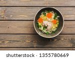 chicken noodle soup on a wooden ... | Shutterstock . vector #1355780669