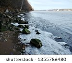 The icy banks of the Hudson River viewed from the Shore Trail in Palisades Interstate Park at Alpine, New Jersey