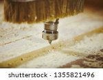 cutting wood using a machine... | Shutterstock . vector #1355821496