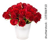 Stock photo bouquet of red roses in a white bucket isolated on white background 135586910