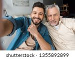 Happy Bearded Son Taking Selfi...