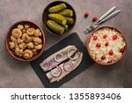 Stock photo traditional russian appetizers sauerkraut with cranberries pickles pickled champignon mushrooms 1355893406